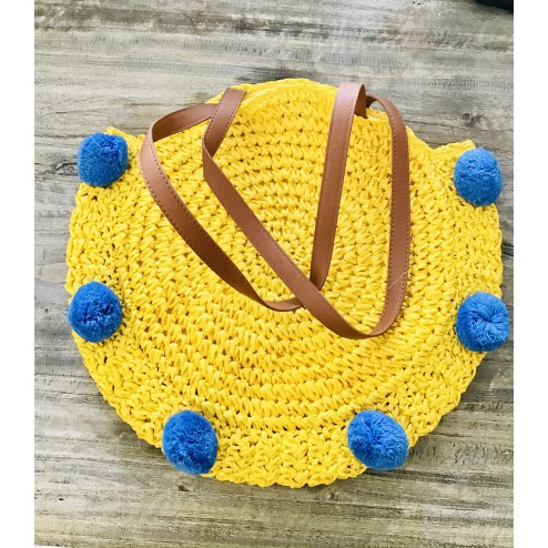 Round beachbag with pompons in yellow