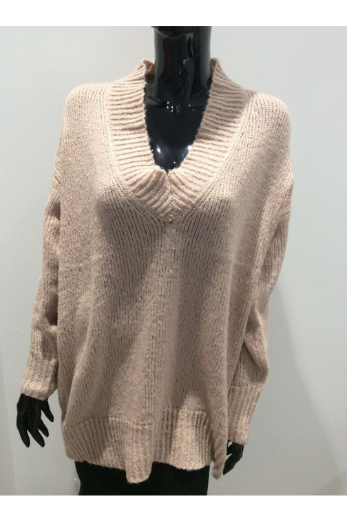 Oversized v-hals truii in nude.