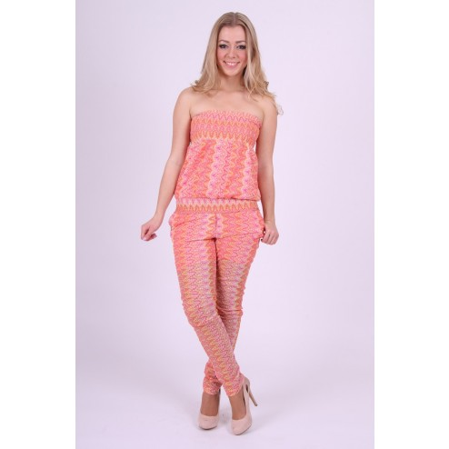 Jumpsuit van Jacky Luxury in Missoni print in coral.
